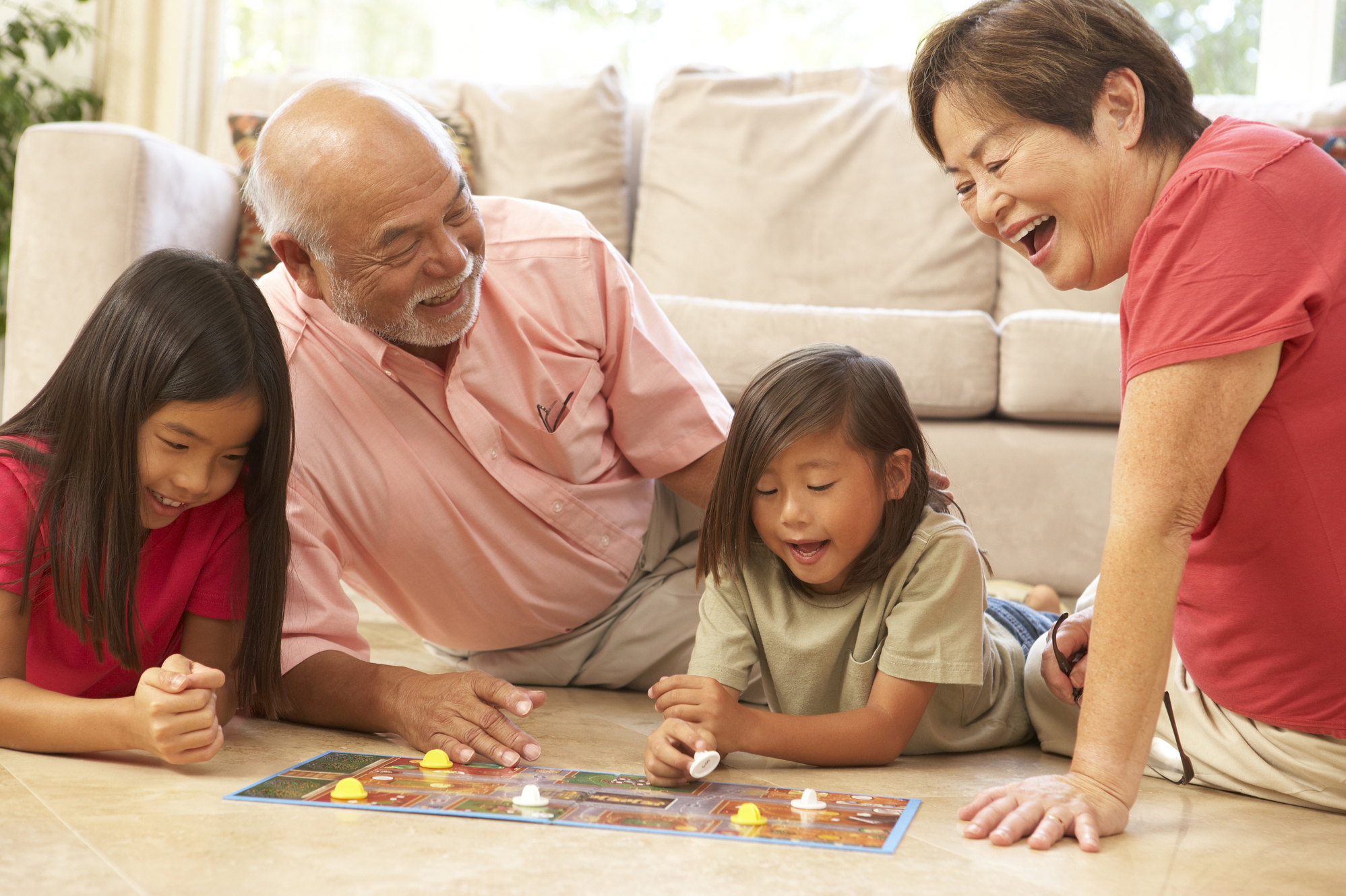Grandparents and grandchildren at home playing a game